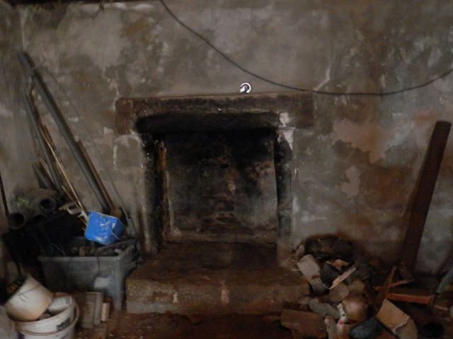 renovation project uncovering a stone fire place