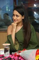 Pragya Jaiswal in a single Sleeves Off Shoulder Green Top Black Leggings promoting JJN Movie at Radio City 10.08.2017 032.JPG