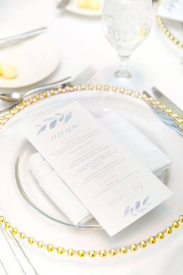 white and gold setting with charger