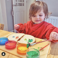child painting bread with dairy free edible paint