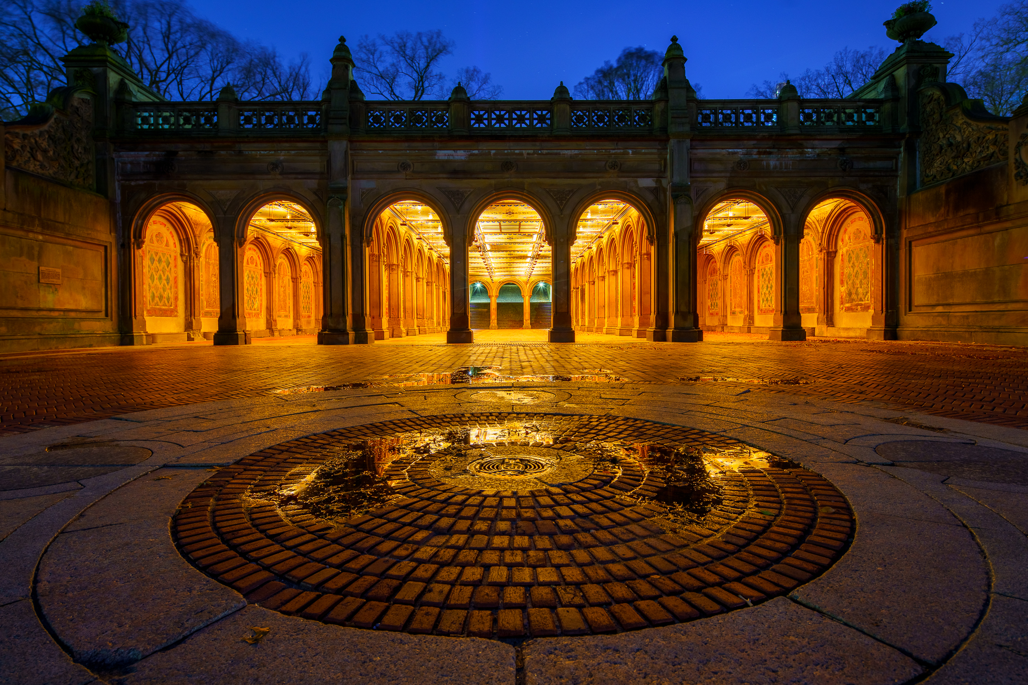 a photo of bethesda terrace at night in central park new york