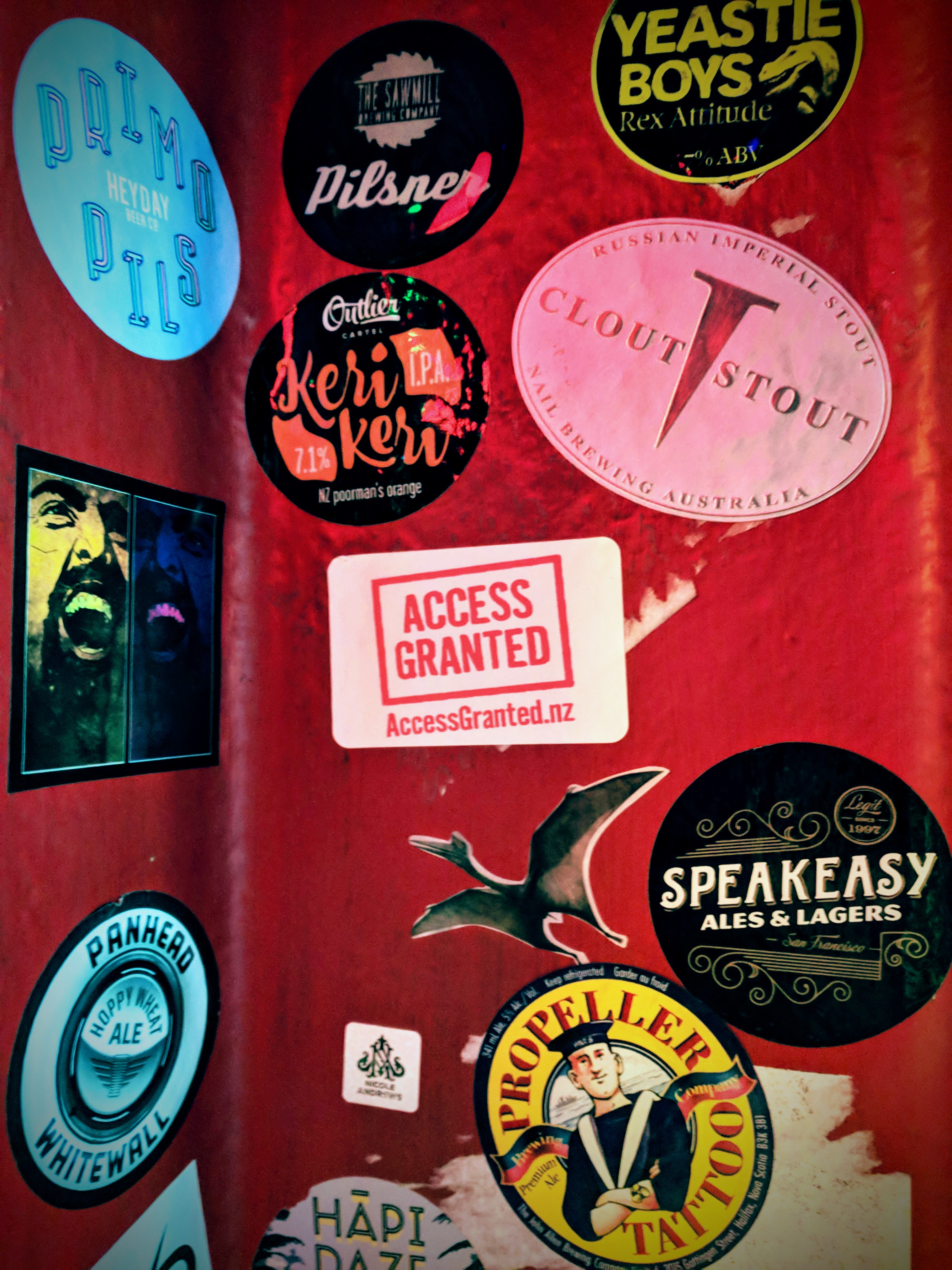 Access Granted NZ sticker amongst others at a pub