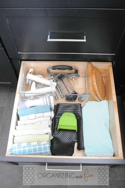 Organized linens in deep drawer in kitchen cabinets :: OrganizingMadeFun.com
