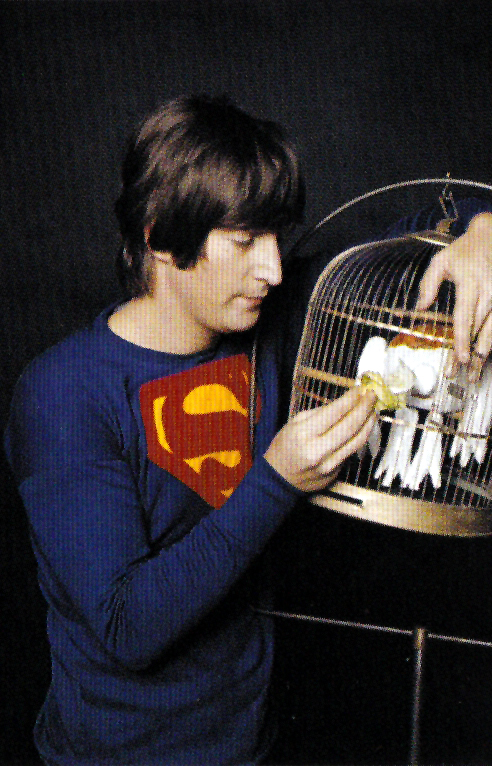 Funny Pictures Of John Lennon Wearing A Superman Shirt In 1965
