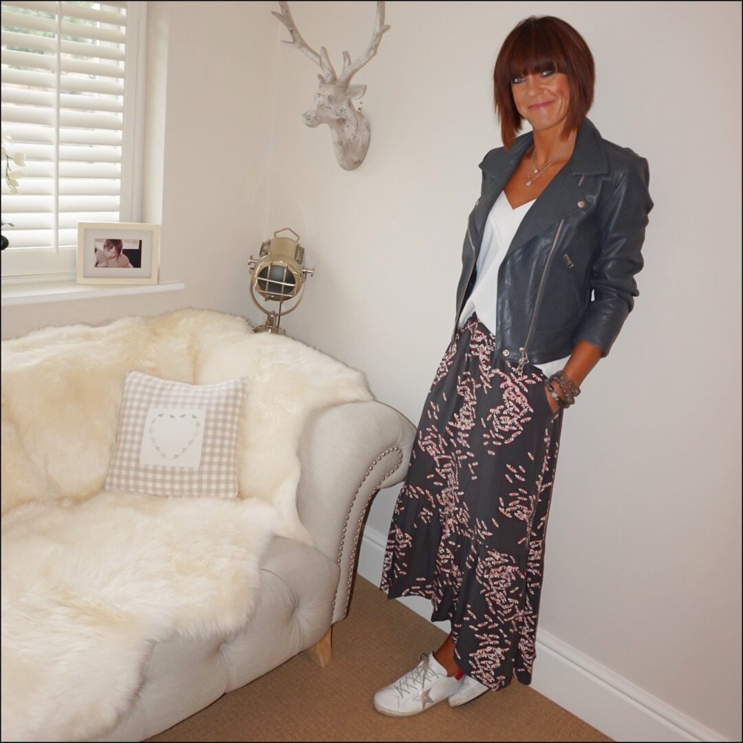 my midlife fashion, hush onyx leather jacket, mango flowy camisole, hush floral tiered maxi skirt, golden goose superstar low top leather trainers