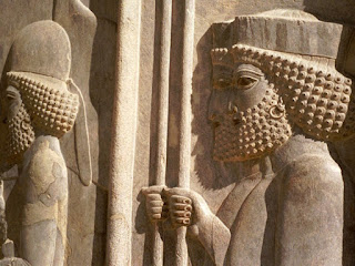 Ancient Persian city of Persepolis, founded by Darius the Great around 518 B.C. shows elaborate wall carvings of men wearing hoop earrings