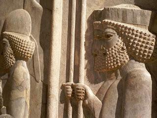 Ancient Persian city of Persepolis, founded by Darius the Great around 518 B.C. shows elaborate wall carvings of men wearing hoop earrings