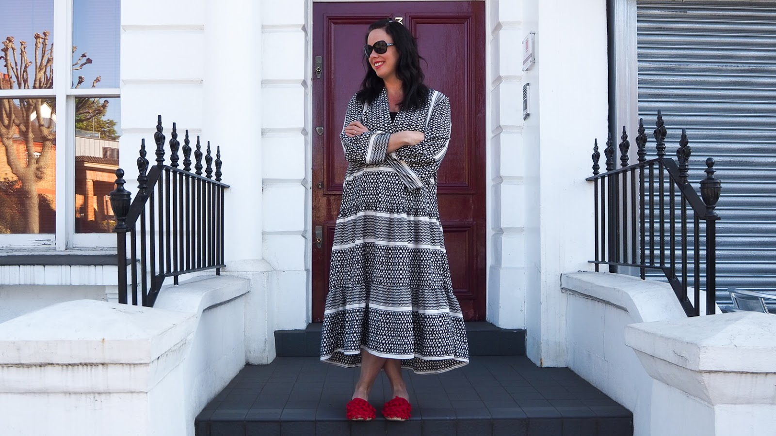 Black and white patterned smocked maxi dress with bell sleeves