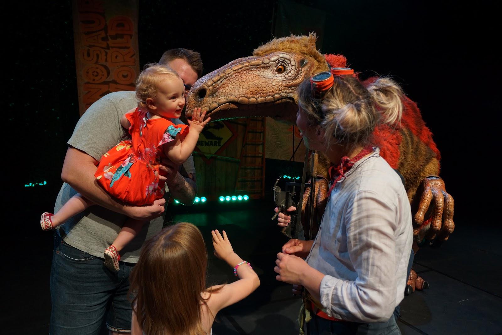 petting a dinosaur