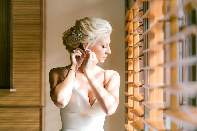 bride getting ready by window