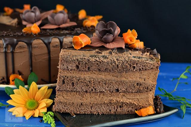 https://www.caietulcuretete.com/2018/03/tort-cu-crema-de-ciocolata-si-portocale.html