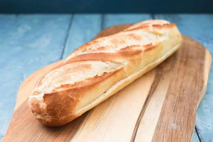 French baguette on a wooden board