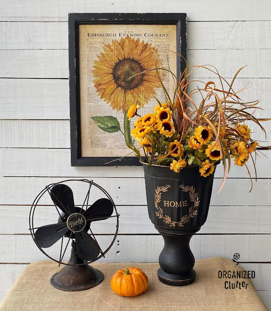 Photo of a DIY black painted urn with fall decor