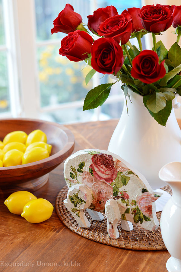 Cottage Style Wooden Pig on a table with lemons and roses