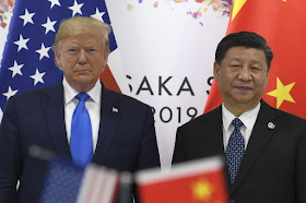 Image Attribute: U.S. President Donald Trump, left, poses for a photo with Chinese President Xi Jinping during a meeting on the sidelines of the G-20 summit in Osaka on June 29, 2019. Photographer: Susan Walsh/AP