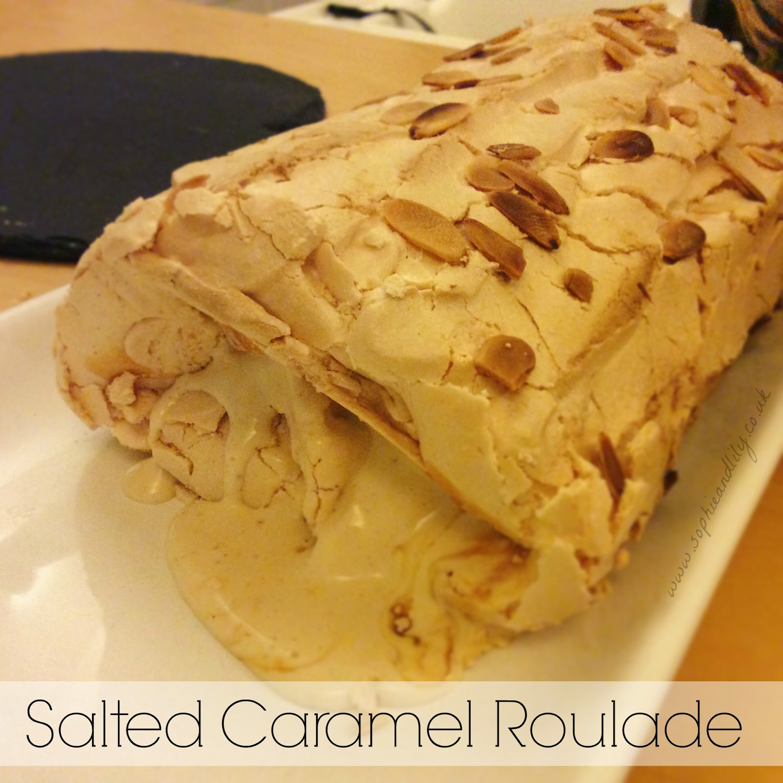 Salted caramel ice cream filled roulade topped with flaked almonds