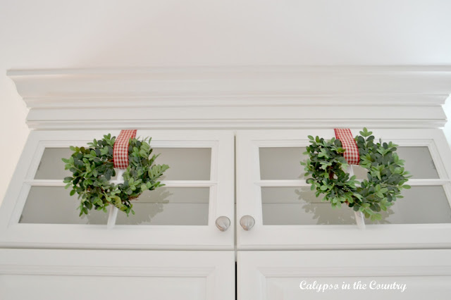 Glass Stacked Cabinets with mini wreaths