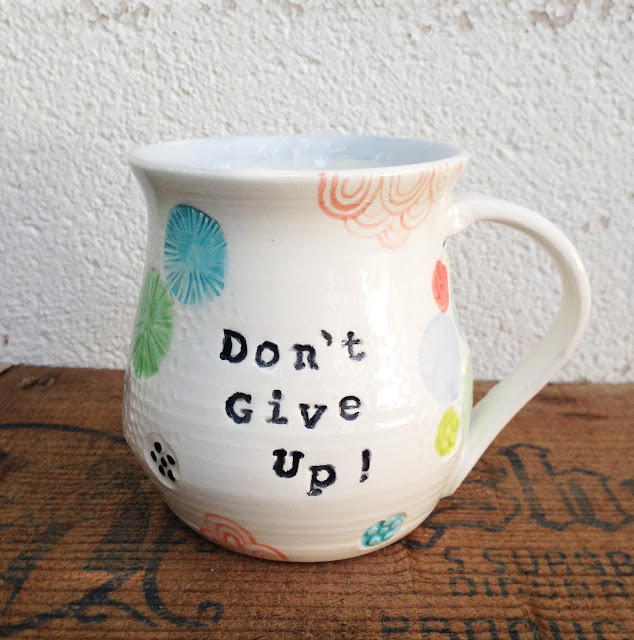 don't give up stamped ceramic mug