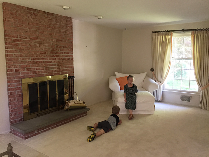 Kids sitting and playing in traditional colonial living room