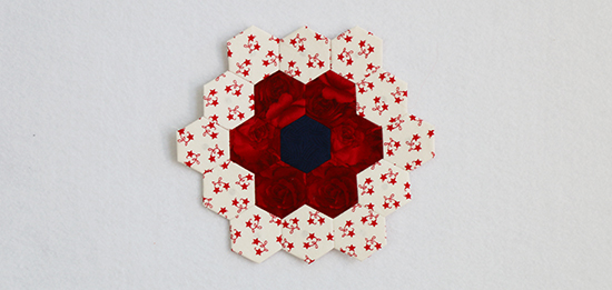 Hand Sewn English Paper Piecing Block Number Seven in Red and Star Print