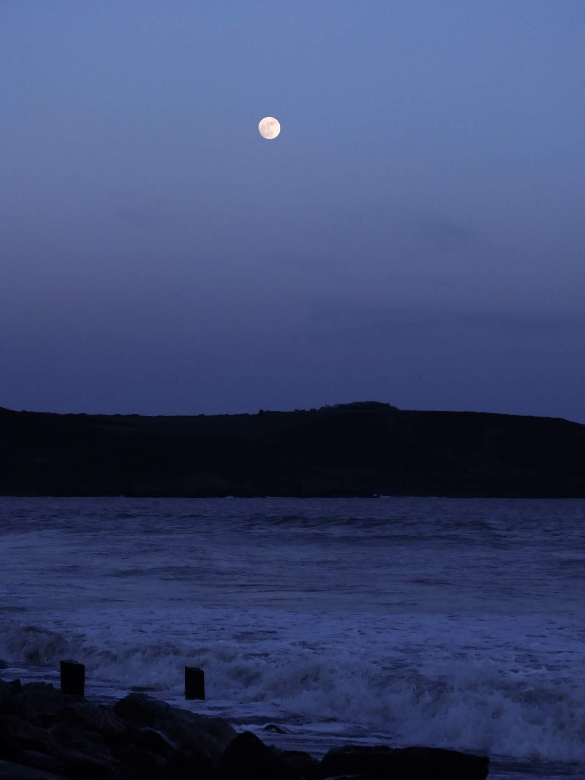 Blue hour moon-scape over the water in Youghal, County Cork.