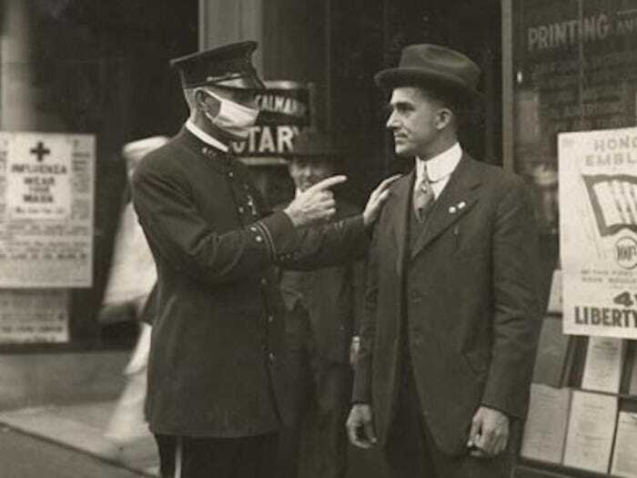 #5 A Policeman In San Francisco Scolds A Man For Not Wearing A Mask During The 1918 Influenza Pandemic, 1918