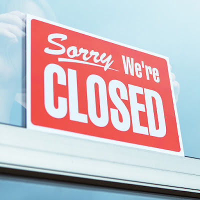 graphic shows a closed sign in a window