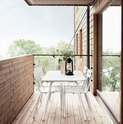 Minimalist balcony decorating idea with white table and chairs