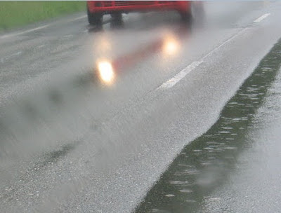 Vehicle struggling with skidding due to Hydroplaning on concrete pavement
