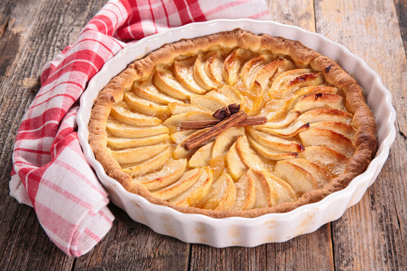 Dish apple pie on a wooden table