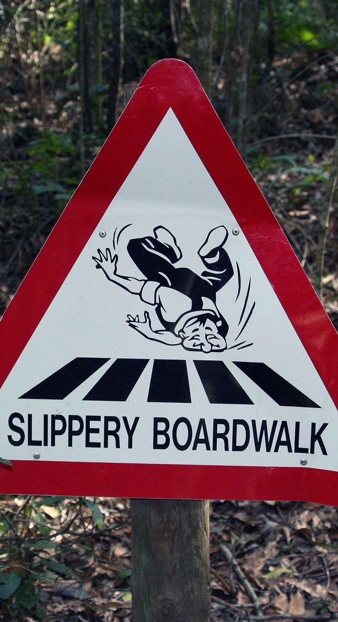 Slippery boardwalk humorous sign.