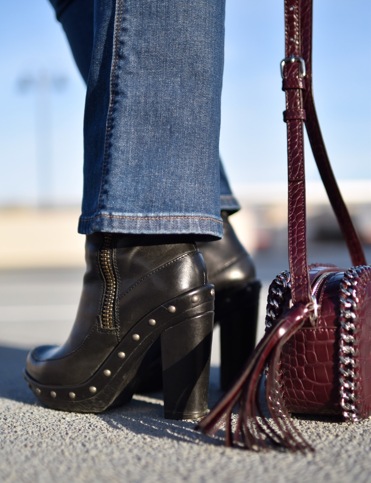 Monika Faulkner outfit inspiration - cropped flare jeans, platform booties, maroon cross-body bag
