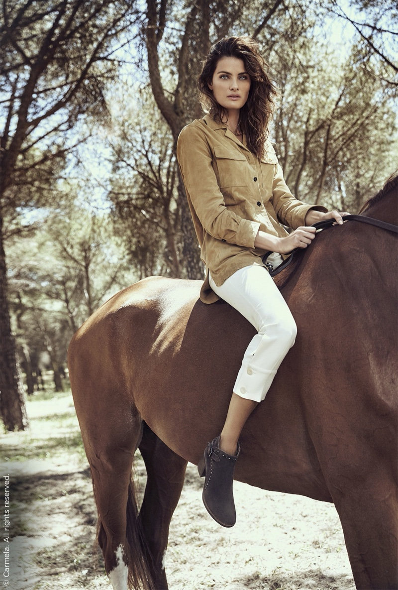 Isabeli Fontana rides a horse in Carmela Shoes fall-winter 2019 campaign