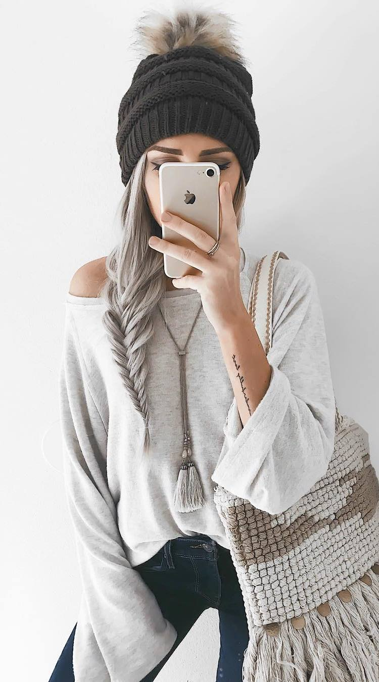 how to style a knit hat : one shoulder sweater + bag + skinny jeans