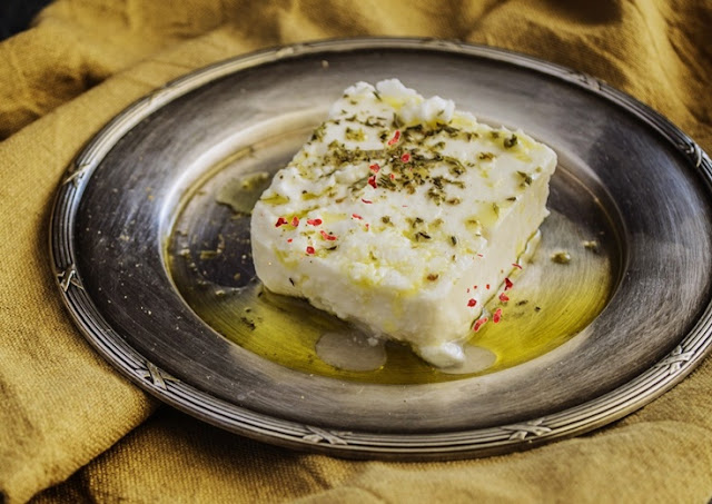 baked feta cheese with olive oil, hebs, garlic and chili