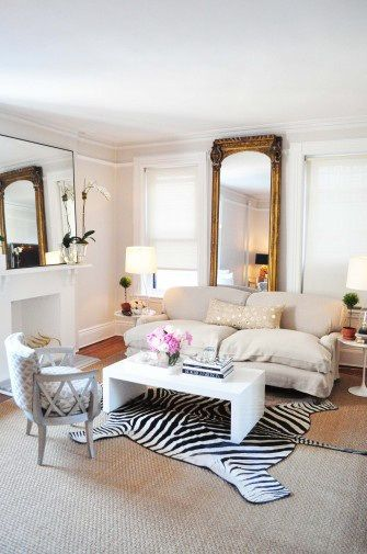 Nice I couldn ut imagine that personally then I went on pinterest and found several living rooms that had a huge mirror turned vertical behind the sofa