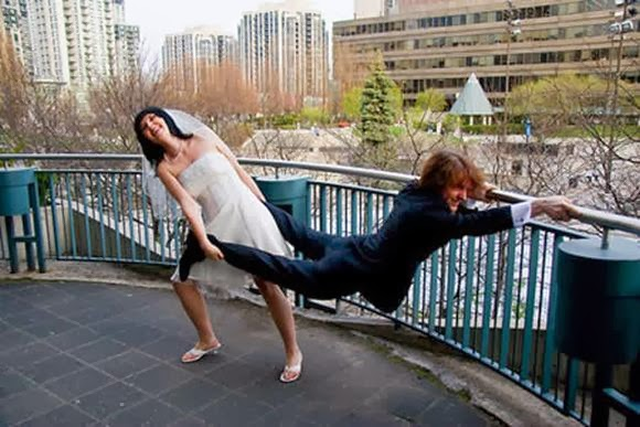 funny wedding picture - bride tring to drag groom away