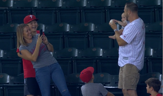 Phillies fan catches foul ball while holding baby 8/7/2019