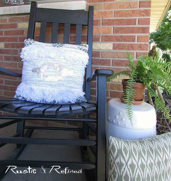 Porches with rocking chairs on them decorated for summer
