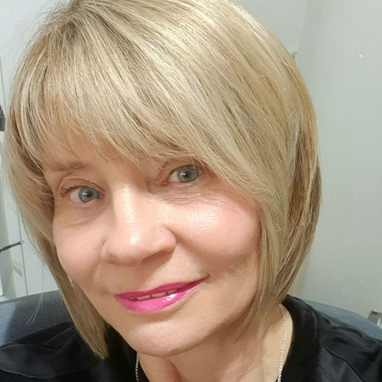 Ageing gracefully over 50 - blonde hair and bright pink lipstick