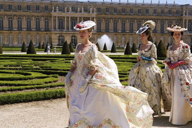 Marie Antoinette walking in the gardens of Versailles
