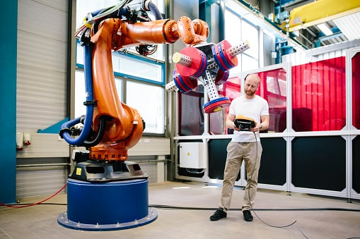Engineer control the industrial robot by using remote control in factory - Robotic Process Automation (RPA)
