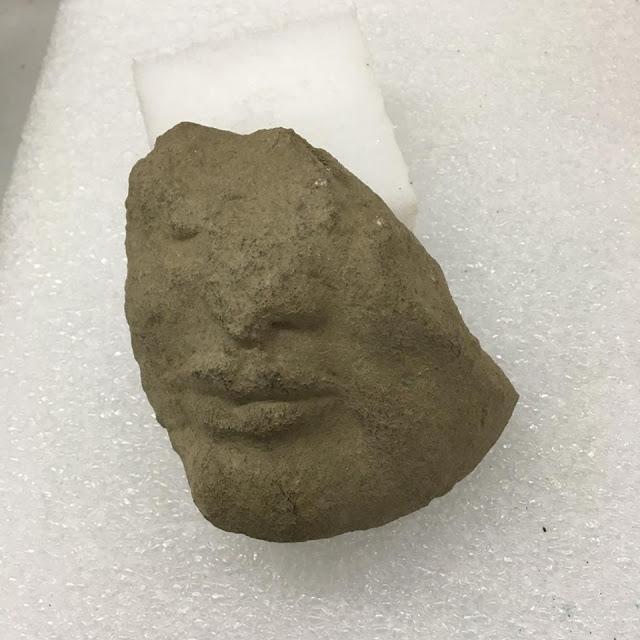 Archaic stone head found in Paestum temple