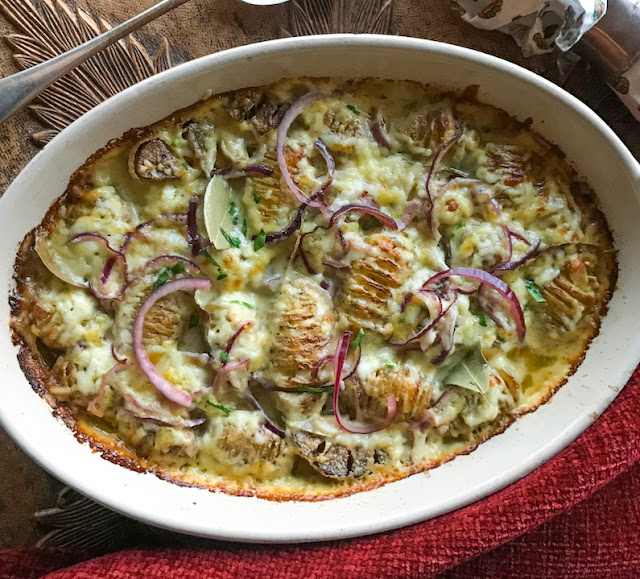 "Food Lust People Love: There are two stars of this recipe for hasselback fondue potato bake: First up are the new potatoes, sliced and roasted, opening up nicely so star number two, the cheese, can melt right inside. The finishing touches of wine and cream, not to mention quick pickled onions, make this dish one you'll cook again and again. This recipe is adapted from one on the .delicious magazine website called hasselback potato bake.  It is described as ""a love affair between crisp, roast potatoes and melted cheese – more specifically fondue."""