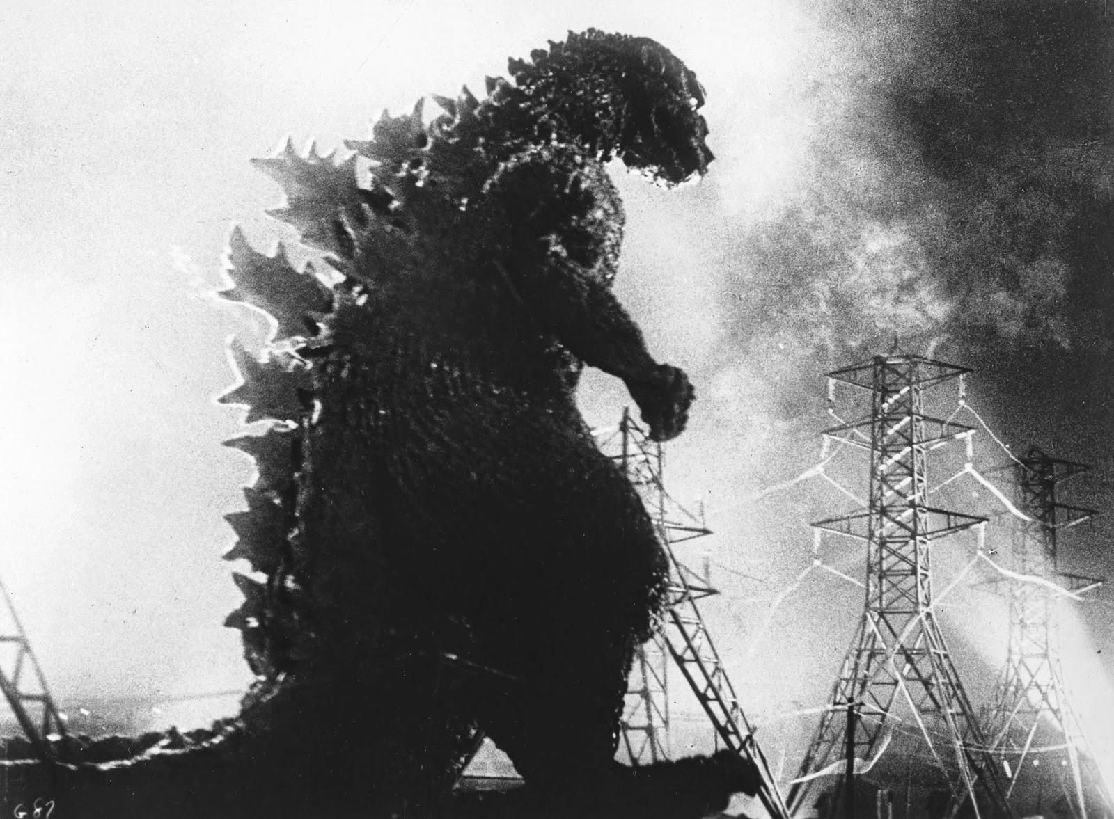 Godzilla majestuoso frente a una central eléctrica