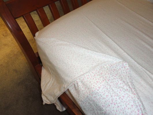 The most important thing when putting on a duvet is making sure you spread it evenly over the bed with the same amount hanging on each side. Once, you've put the duvet cover on your bed, make sure the top edge of the duvet is about six inches away from the edge of the top sheet at the head of the bed.