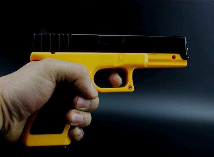 Súng bắn thun Glock như thật