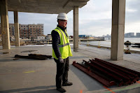 In Boston, more developments are taking sea level rise into account by building up the ground beneath buildings, installing extra-tall ground floors and adding other flood protection. Scientists say they still might not be planning for enough sea level rise. (Credit: Jonathan Wiggs/The Boston Globe via Getty) Click to Enlarge.
