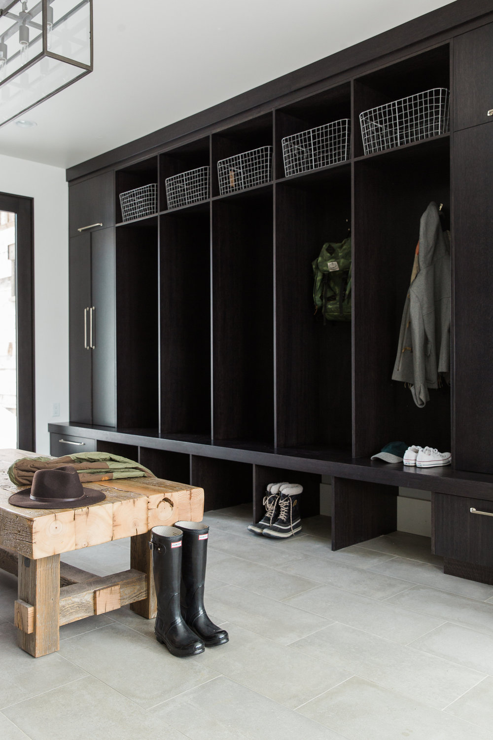 Black painted cabinets in mud room of mountain home