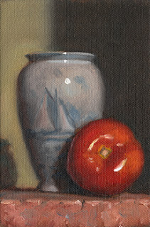 Still life oil painting of a blue vase beside a red tomato.